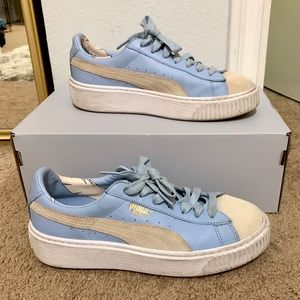 Blue and tan platform Puma shoes